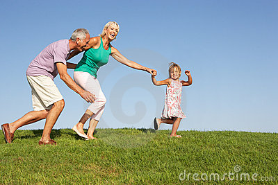 Senior couple, with granddaughter,running