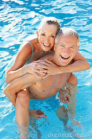 Free Senior Couple Having Fun In Pool Royalty Free Stock Photography - 17069567
