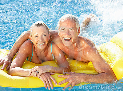 Senior Couple Having Fun In Pool Stock Photography - Image: 17069462