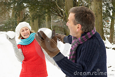 Senior Couple Having Snowball Fight
