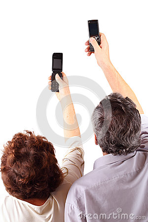 Senior couple hold mobile phones in hand