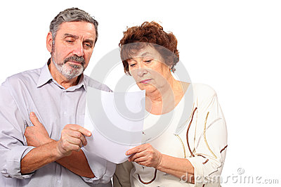 Senior couple hold paper list in hands
