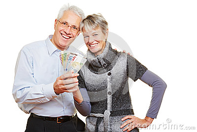 Senior couple holding fan of Euro