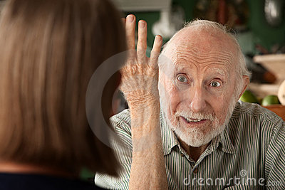 Senior couple at home focusing on angry man