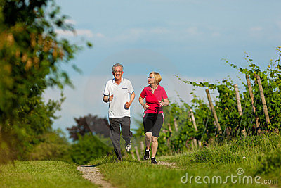 Senior couple jogging for sport