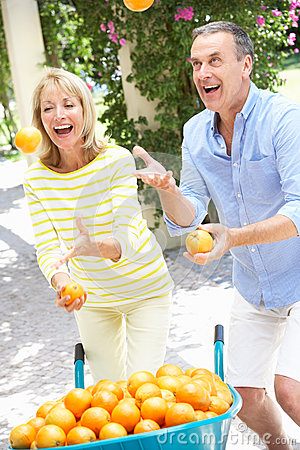 Senior Couple Juggling Oranges