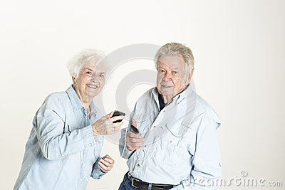 Senior couple listens to music