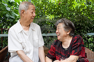A senior couple look at each other.