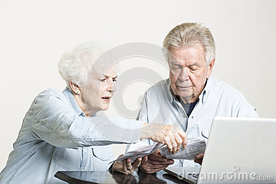 Senior couple is looking at bills concerned