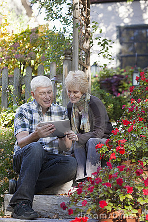 Senior Couple looking at digital tablet