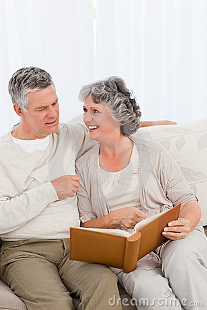 Senior couple looking at their photo album