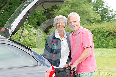 Senior couple with luggage