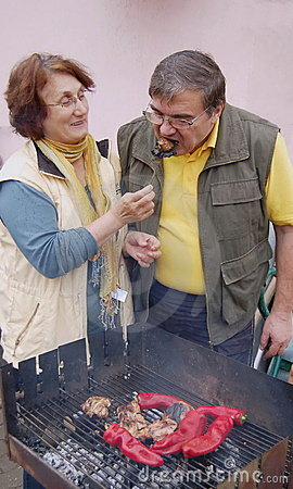 Senior couple making barbecue