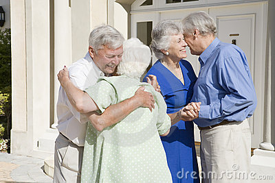 Senior couple meeting friends