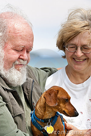 Senior couple with Miniature Dachshund