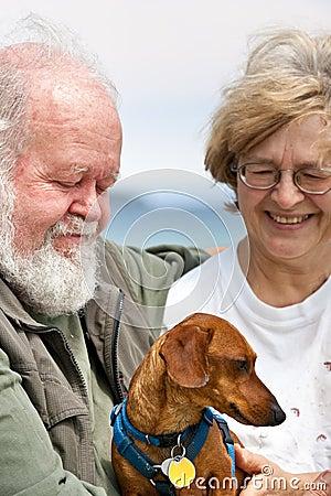Senior couple with Miniature Dachshund
