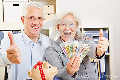 Senior couple with money holding