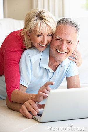 Free Senior Couple On Her Laptop Computer Royalty Free Stock Image - 17067976