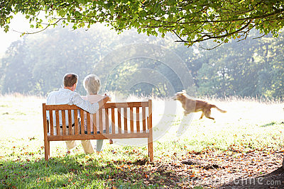 Senior couple outdoors with dog