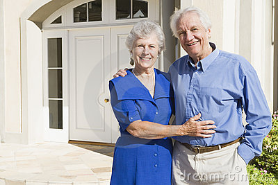 Senior couple outside house