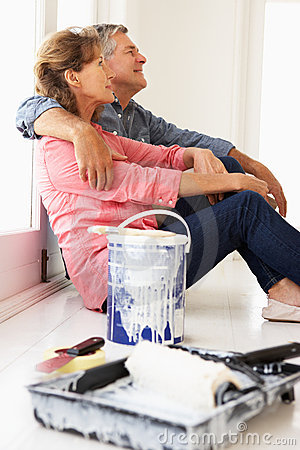 Senior couple painting house