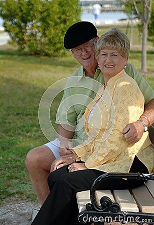 Senior couple on park bench