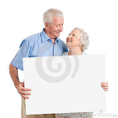 Senior couple with placard