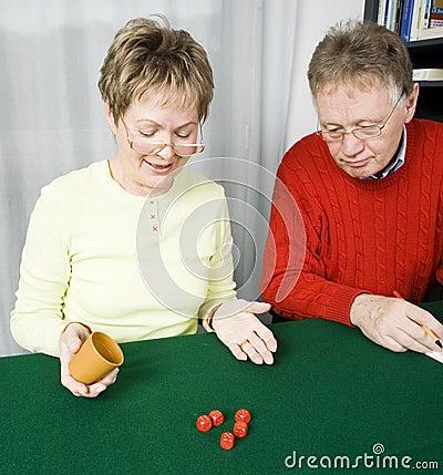 Senior couple playing dice