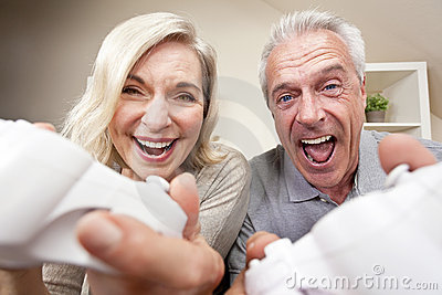 Senior Couple Playing Video Console Game Stock Photo