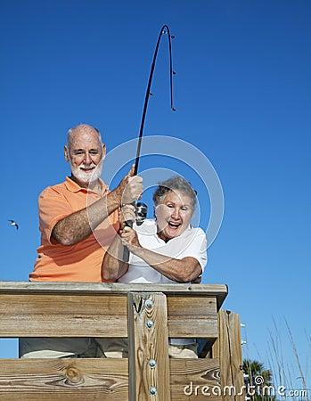 Free Senior Couple Reel In Fish Stock Image - 11754591