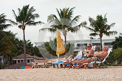 Senior Couple Relaxes In Beach Chairs At Florida Resort Editorial Stock Photo