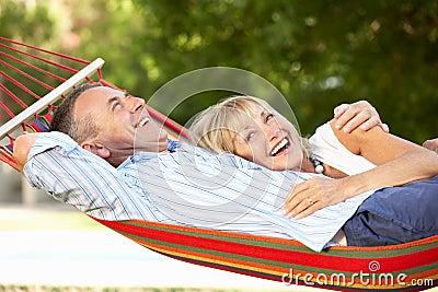 Senior Couple Relaxing In Hammock