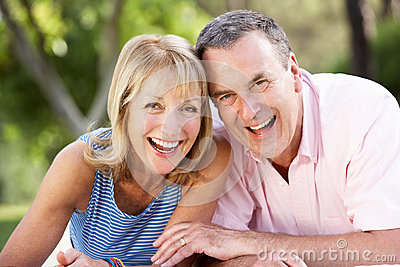 Senior Couple Relaxing In Summer Garden