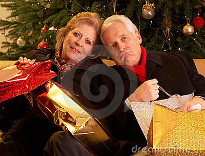 Senior Couple Returning After Christmas Shopping