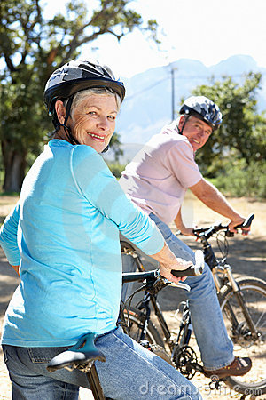 Senior couple riding bikes having fun