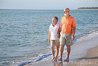 Senior Couple - Romantic Beach Stroll