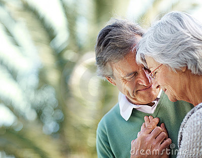 Senior couple in romantic mood in a park