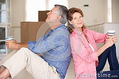 Senior couple sat in new home