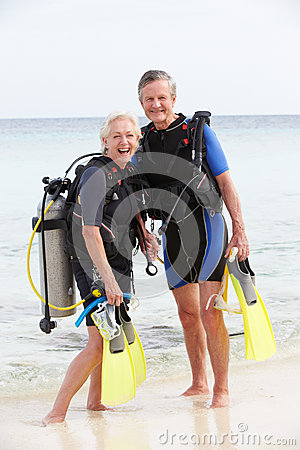 Senior Couple With Scuba Diving Equipment Enjoying Holiday