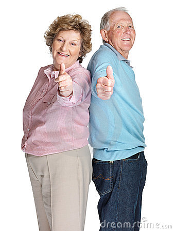 Senior couple showing a thumbs up sign