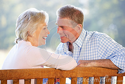 Senior couple sitting outdoors