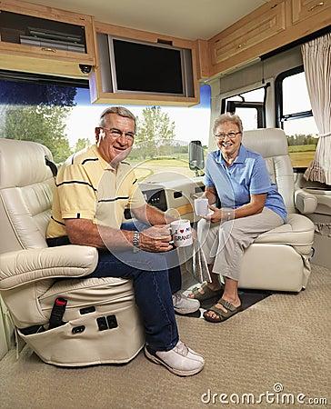 Senior couple sitting in RV.