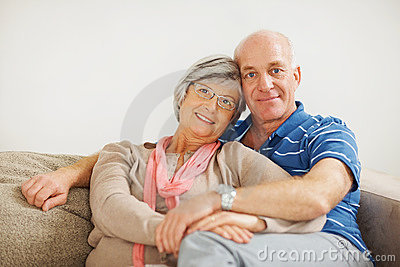 Senior Couple Sitting Together On Couch At Home Royalty Free Stock Photos - Image: 11930868