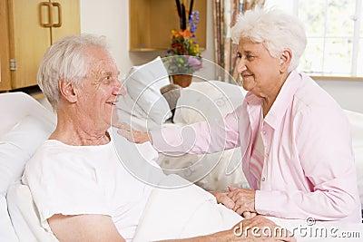 Senior Couple Sitting Together In Hospital