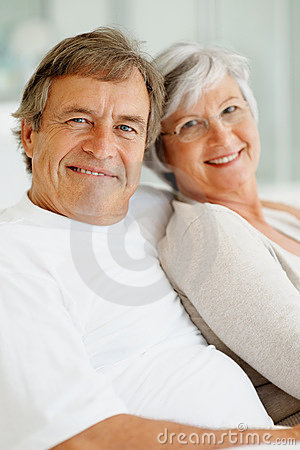 Senior couple sitting together and smiling