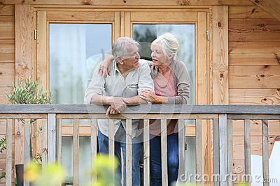 Senior couple standing on terrace Stock Photo