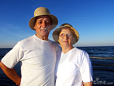 Senior couple at sunset on the beach
