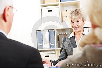 Senior couple taking with bank