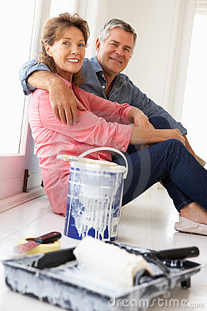 Senior couple taking break from decorating house