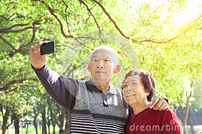 Senior couple taking picture